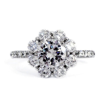 Chunky diamond halo engagement ring named Kendall. Made in NYC using conflict-free diamonds. Dana Walden New York City.