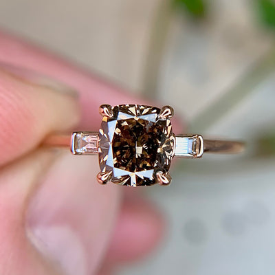 1 carat cushion cut diamond engagement ring with baguette side stones in rose gold by Dana Walden Bridal NYC