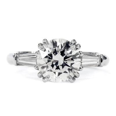 Conflict-free round diamond engagement ring with baguette diamond accents. Made in New York City.