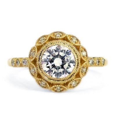 Ornate yellow gold diamond halo engagement ring with milgrain details. Dana Walden NYC.