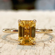 Unique emerald cut yellow sapphire in gold with delicate gold custom setting