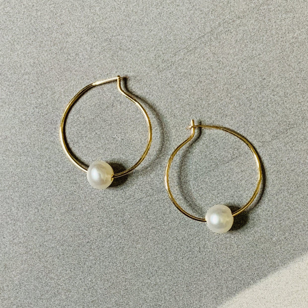Dainty gold-and-pearl hoops, handmade by Dana Walden Jewelry