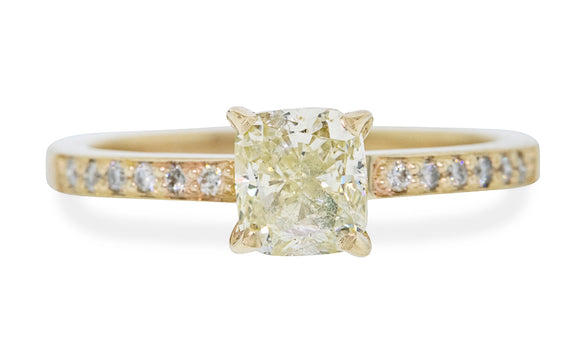 1.01 carat sparkling champagne diamond ring prong set in 14 karat yellow gold with six pave diamonds on each shoulder front view on white background