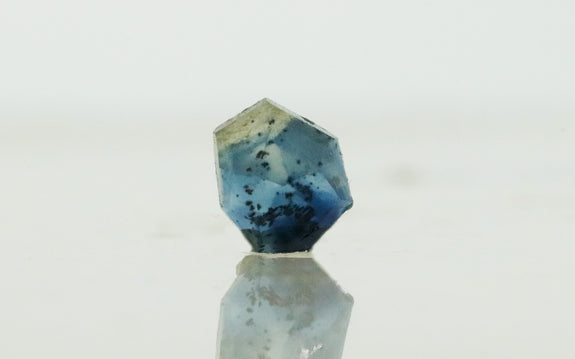 1.04 carat hand cut ocean blues sapphire on white background