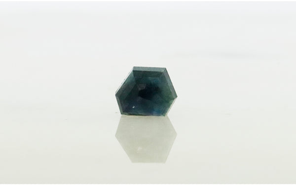 2.75 carat hand cut midnight blue sapphire front view on white background