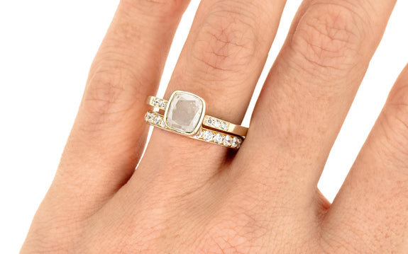 2 Carat Icy White Diamond Ring on a hand with wedding band