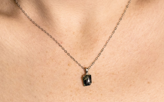 1.84 Carat Hand-Cut Sapphire Necklace on a neck