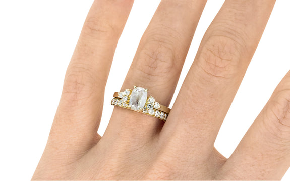 .94 Carat Icy White Diamond Ring on a hand with wedding band