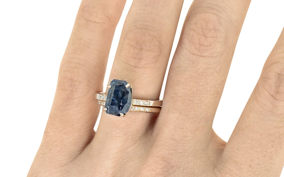 3.08 Carat Hand-Cut Sapphire Ring on hand with wedding band