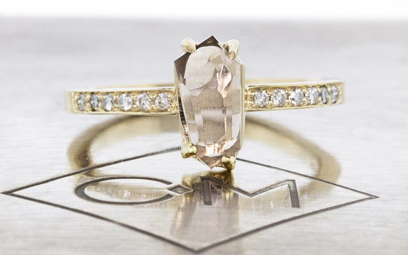 1.05 Carat Hand-Cut Rosy Champagne Montana Sapphire Ring front view on logo