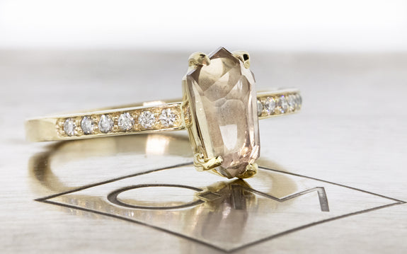 1.05 Carat Hand-Cut Rosy Champagne Montana Sapphire Ring three quarter view on logo
