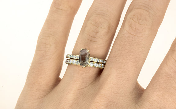 1.05 Carat Hand-Cut Rosy Champagne Montana Sapphire Ring on a hand with wedding band