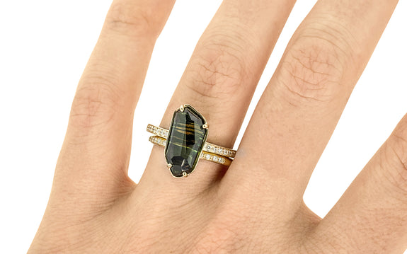3.80 Carat Hand-Cut Australian Dog Tooth Sapphire Ring on a hand with wedding band