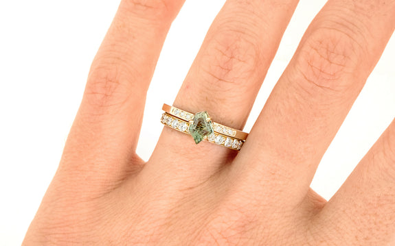 .97 Carat Hand-Cut Green Montana Sapphire Ring on a hand with wedding band