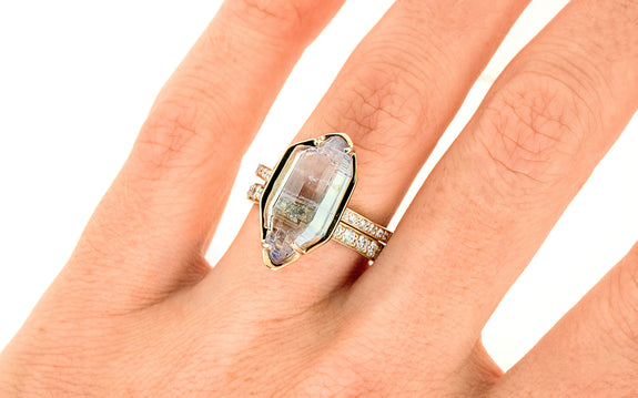 7.70 Double-Cut White/Lavender Sapphire Ring on a hand with wedding band
