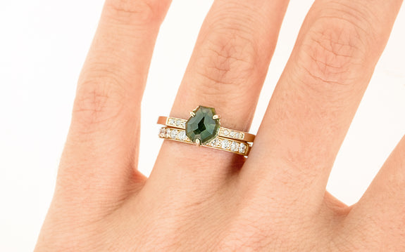 2.11 Carat Hand-Cut Green Sapphire Ring on a hand with wedding band