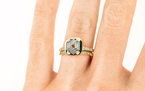 AIRA Ring in Yellow Gold with 1.58 Carat Champagne Diamond on a hand with wedding band