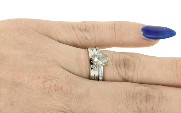 1.02 Carat Light Champagne Diamond Ring stacked on a hand with wedding band
