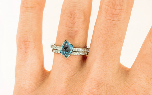 .92 Carat Double-Cut Vibrant Blue Montana Sapphire Ring on a hand with wedding band