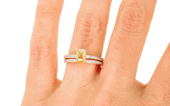 .92 Carat Amber Diamond Ring in Rose Gold stacked on a hand with wedding band