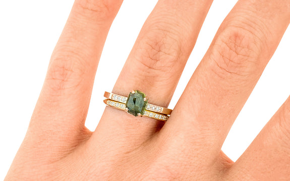 1.86 Carat Hand-Cut Green Sapphire Ring stacked on a hand with wedding band
