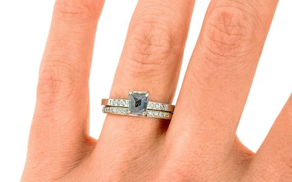 1.37 Carat Hand-Cut Blue Montana Sapphire Ring stacked on a hand with wedding band