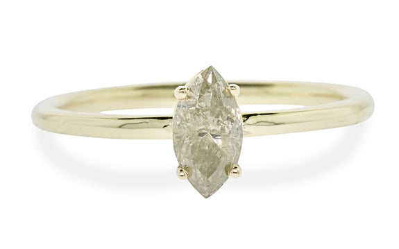 Pear shaped champagne diamond set in yellow gold ring front view on white background