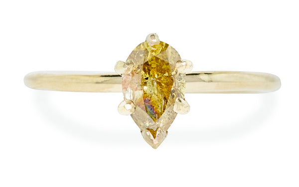 Pear shaped honey champagne diamond set in yellow gold front view with white background