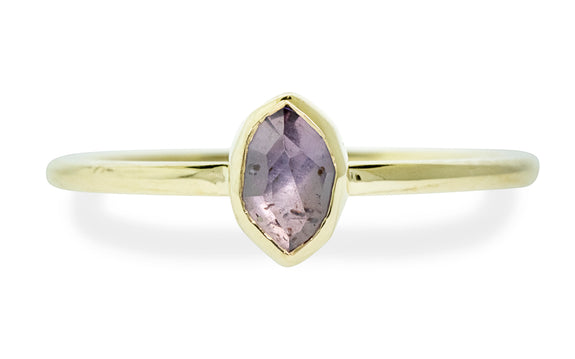 .77 carat hand cut purple sapphire in bezel setting in 14 karat yellow gold front view on white background