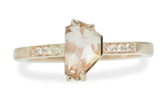 1.57 carat hand cut white peach Montana sapphire with 3 pave diamonds each side set in rose gold front view on white background