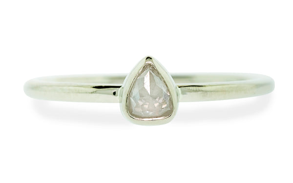 .30 carat icy white diamond bezel set in white gold front view on white background