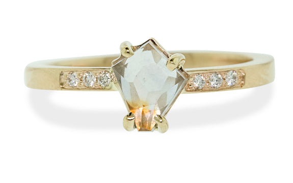 .95 carat Hand Cut sea foam and peach Montana sapphire set in 14 karat yellow gold with three pave diamonds on each side front view on white background