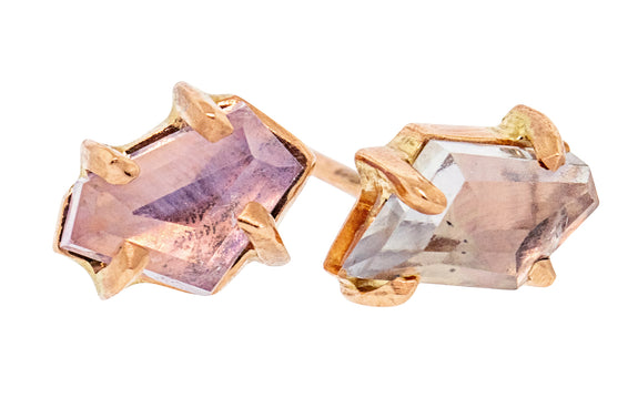Pair of hand-cut violet Montana sapphire earrings in rose gold front view on white background