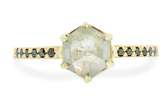 1.71 carat glowing gray diamond ring in yellow gold with six black pave diamonds on each side front view on a white background
