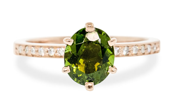 1.37 carat green tourmaline with six pave diamonds on each side set in 14 karat rose gold front view on white background
