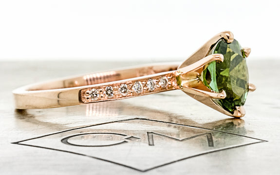 1.37 carat green tourmaline with six pave diamonds on each side set in 14 karat rose gold side view on Chinchar Maloney metal plate