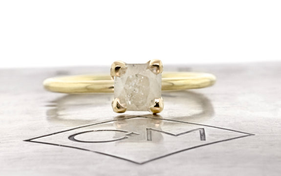 1.36 carat icy white diamond set in 14 karat yellow gold front view on Chinchar Maloney metal plate