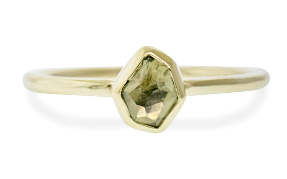 .78 carat hand cut dusted olive green Montana sapphire ring bezel set in 14 karat yellow gold front view on white background