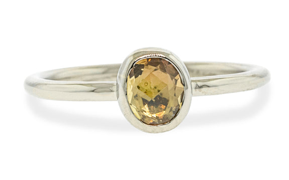 .72 carat hand cut tupelo honey sapphire ring bezel set in 14 karat white gold front view on white background