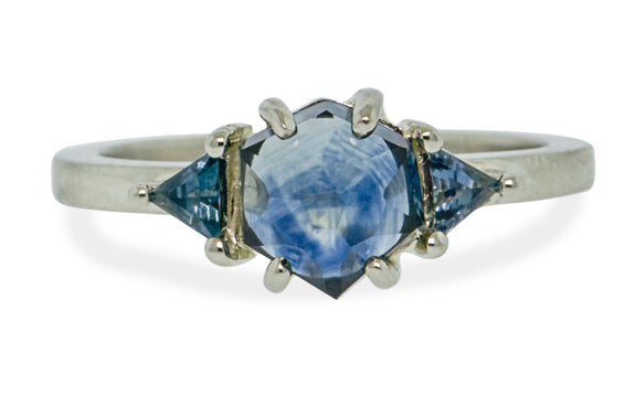 1.63 carat windy blue Montana sapphire ring set in 14 karat white gold with one trillion cut blue sapphire on each shoulder front view on white background