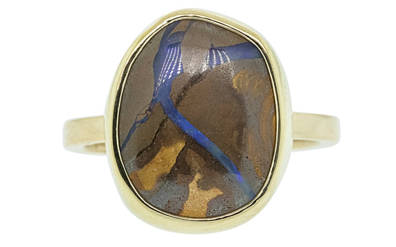 6.18 carat boulder opal ring in 14 karat yellow gold front view on white background