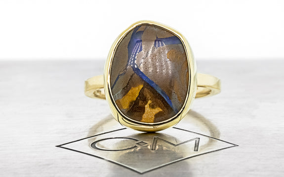 6.18 carat boulder opal ring in 14 karat yellow gold front view on Chinchar Maloney metal plated