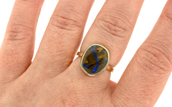 6.18 carat boulder opal ring in 14 karat yellow gold front view on finger