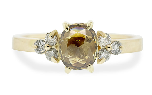 .86 carat oval whiskey diamond ring in 14 karat yellow gold with three 2mm gray diamonds set in clusters on each side front view on white background