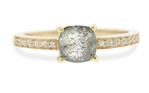 1.10 carat salt & pepper diamond ring set in 14 karat yellow gold with six white pavé diamonds on each shoulder front view on white background.