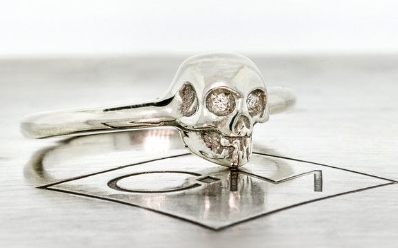 Diamond & Garnet Skull Ring front view on logo