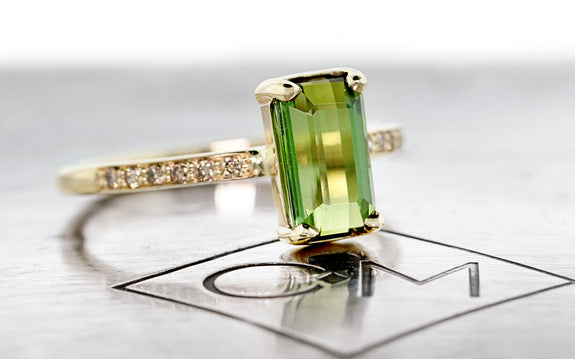 1.73 Carat Green Tourmaline Ring three quarter view on logo