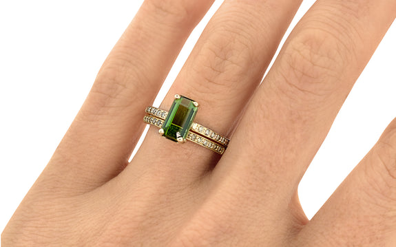 1.73 Carat Green Tourmaline Ring on a hand with wedding band