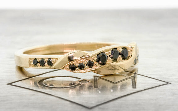 Twisted Wedding Band with Black Diamonds side view on logo