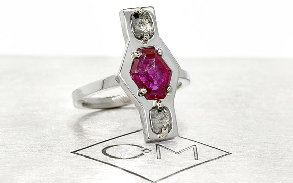 Salt & Pepper Diamond and Ruby Ring front view on logo